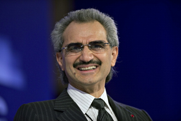 "Prince Alwaleed Bin Talal, Saudi billionaire and founder of Kingdom Holding Co., smiles while speaking at the Bloomberg Year Ahead: 2014 conference in Chicago, Illinois, U.S., on Wednesday, Nov. 20, 2013. Alwaleed said President Barack Obama lacks a ""comprehensive and coherent foreign policy"" toward the Arab world. Photographer: Daniel Acker/Bloomberg via Getty Images"